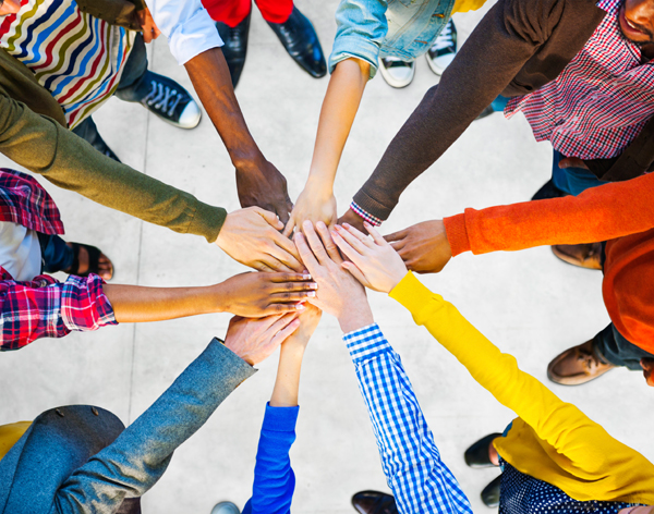 Hands Coming Together To Form Social Online Community